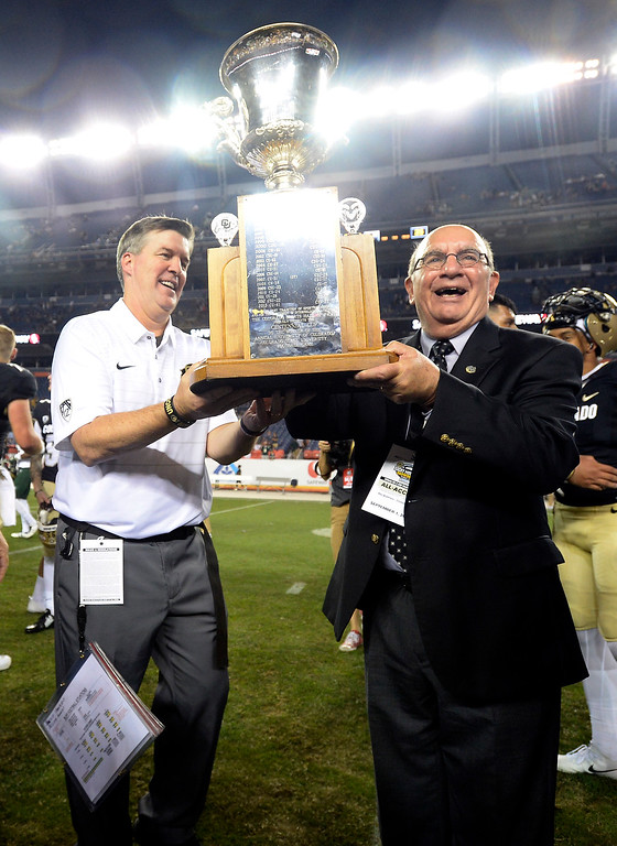 . Head coach, Mike MacIntyre and Chancellor, Phil DiStefano, hold the Centennial Cup after CU beat CSU at  the Rocky Mountain Showdown in Denver.  Cliff Grassmick / Staff Photographer/ September 1, 2017