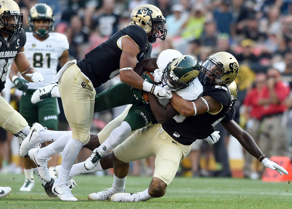 . University of Colorado\'s Drew Lewis, at right, makes a tackle during the Rocky Mountain Showdown against Colorado State University on Friday at Sports Authority Field in Denver. CU won the game 17-3. More photos: Buffzone.com Jeremy Papasso/ Staff Photographer/ Sept. 1, 2017