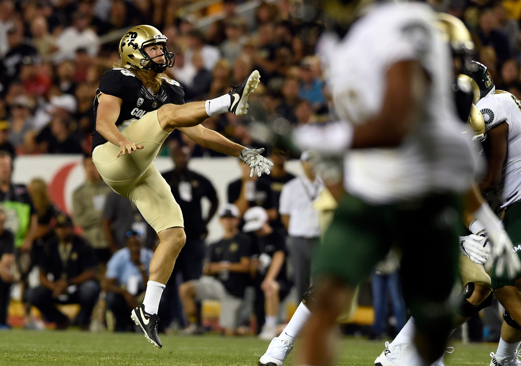 . University of Colorado\'s Alex Kinney punts the ball in the second half of the Rocky Mountain Showdown against Colorado State University on Friday at Sports Authority Field in Denver. More photos: Buffzone.com Jeremy Papasso/ Staff Photographer/ Sept. 1, 2017
