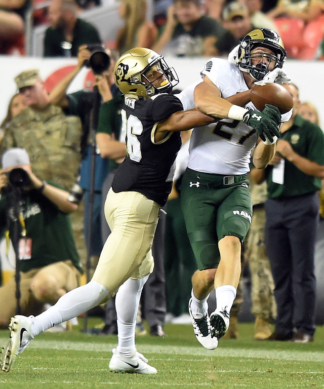 . Isaiah Oliver, of CU, defends a pass to Trey Smith, of CSU, in the second half of the Rocky Mountain Showdown in Denver.  Cliff Grassmick / Staff Photographer/ September 1, 2017