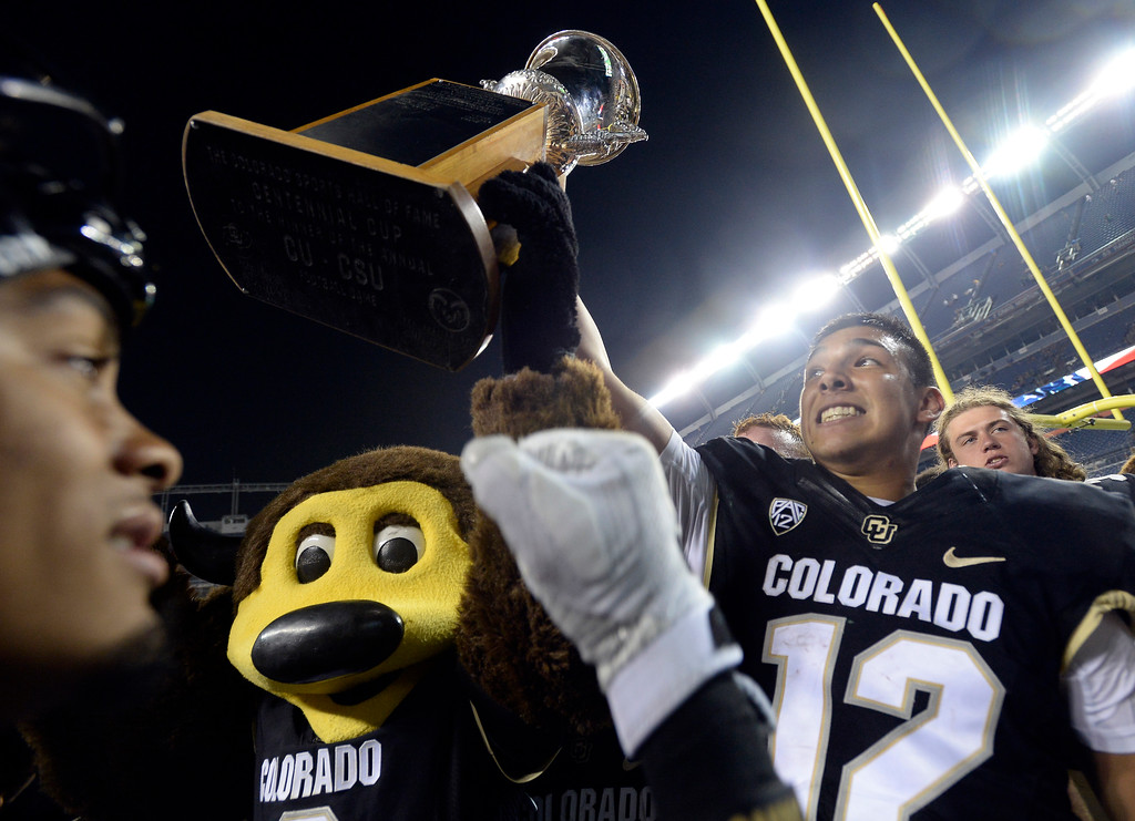 . Chip and Steven Montez hold the Centennial Cup at the end of the Rocky Mountain Showdown in Denver.  Cliff Grassmick / Staff Photographer/ September 1, 2017