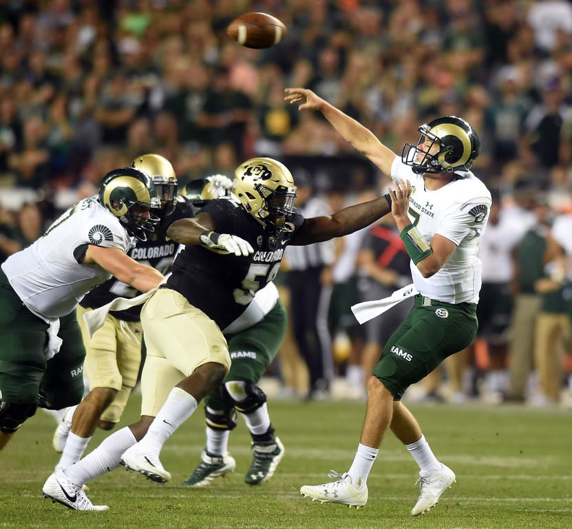 . CSU QB, Nick Stevens, is pressured by Leo Jackson III, of CU, in the second half of the Rocky Mountain Showdown in Denver.  Cliff Grassmick / Staff Photographer/ September 1, 2017