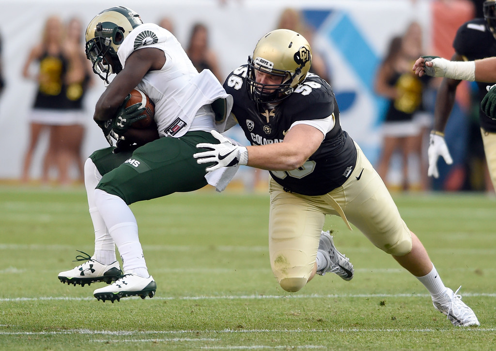 . University of Colorado\'s Tim Lynott Jr. makes a tackle during the Rocky Mountain Showdown against Colorado State University on Friday at Sports Authority Field in Denver. More photos: Buffzone.com Jeremy Papasso/ Staff Photographer/ Sept. 1, 2017