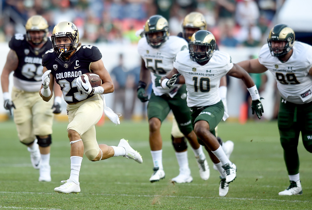 . Phillip Lindsay, of CU, gets past the CSU defense for the TD run during the first half of the Rocky Mountain Showdown in Denver.  Cliff Grassmick / Staff Photographer/ September 1, 2017