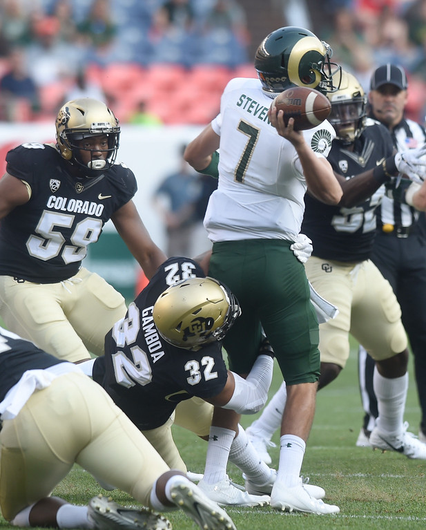 . CSU QB, Nick Stevens, is pressured by Rick Gamboa, of CU, during the first half of the Rocky Mountain Showdown in Denver.  Cliff Grassmick / Staff Photographer/ September 1, 2017