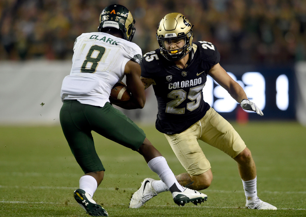 . University of Colorado\'s Ryan Moeller works to make a tackle on Detrich Clark during the Rocky Mountain Showdown against Colorado State University on Friday at Sports Authority Field in Denver. More photos: Buffzone.com Jeremy Papasso/ Staff Photographer/ Sept. 1, 2017