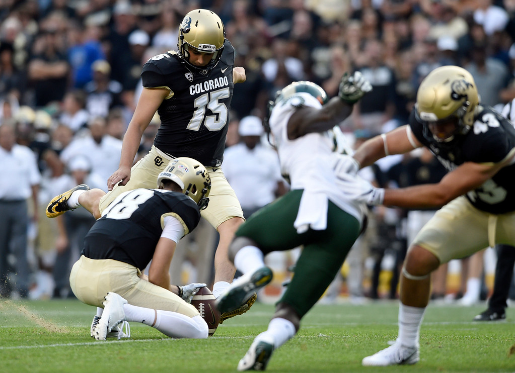 . University of Colorado\'s Chris Graham kicks an extra point after a Buffaloe touchdown during the Rocky Mountain Showdown against Colorado State University on Friday at Sports Authority Field in Denver. More photos: Buffzone.com Jeremy Papasso/ Staff Photographer/ Sept. 1, 2017
