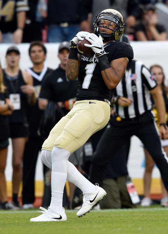 . University of Colorado\'s Shay Fields catches a touchdown pass in the first half during the Rocky Mountain Showdown against Colorado State University on Friday at Sports Authority Field in Denver. CU won the game 17-3. More photos: Buffzone.com Jeremy Papasso/ Staff Photographer/ Sept. 1, 2017