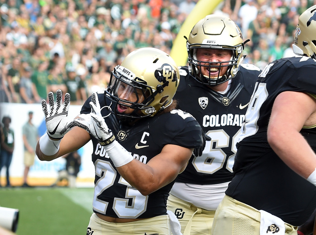 . Phillip Lindsay, of CU, celebrates his TD run with Gerrad Kough during the first half of the Rocky Mountain Showdown in Denver.  Cliff Grassmick / Staff Photographer/ September 1, 2017