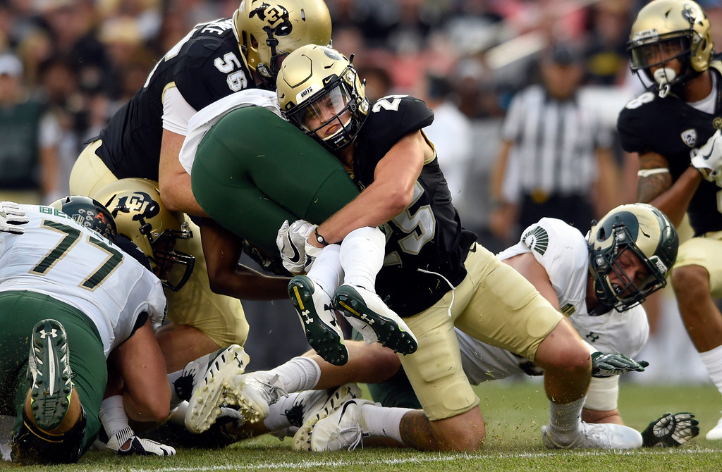 . University of Colorado\'s Ryan Moeller makes a tackle on Dalyn Dawkins during the Rocky Mountain Showdown against Colorado State University on Friday at Sports Authority Field in Denver. More photos: Buffzone.com Jeremy Papasso/ Staff Photographer/ Sept. 1, 2017