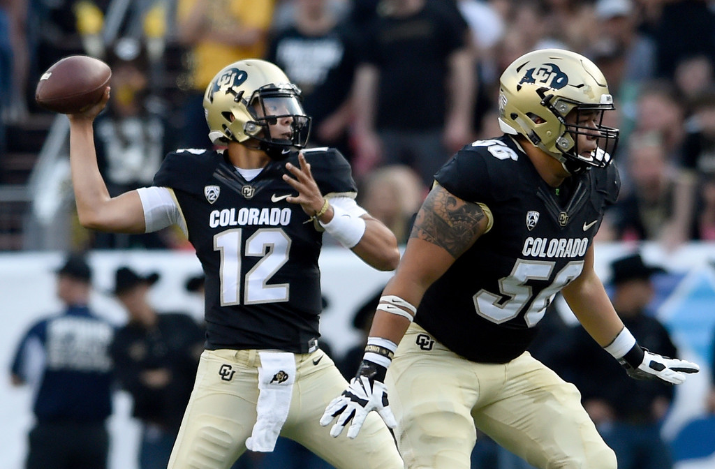 . University of Colorado quarterback Steven Montez throws a pass during the Rocky Mountain Showdown against Colorado State University on Friday at Sports Authority Field in Denver. More photos: Buffzone.com Jeremy Papasso/ Staff Photographer/ Sept. 1, 2017