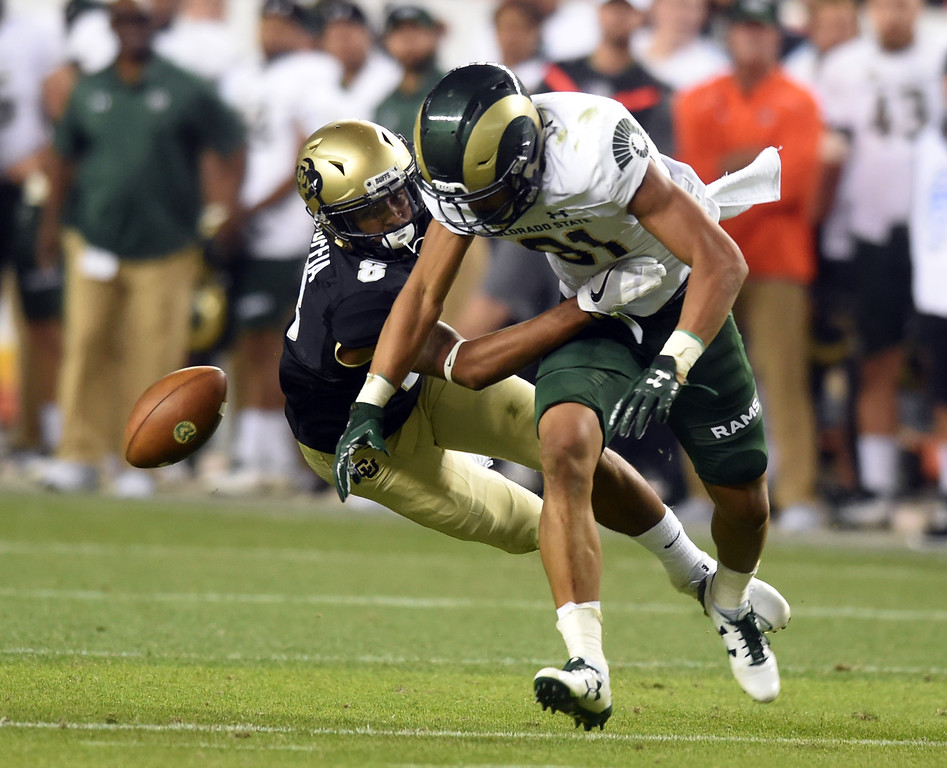 . Trey Udoffia, of CU knockds the ball away from Olabisi Johnson, of CSU, in the second half of the Rocky Mountain Showdown in Denver.  Cliff Grassmick / Staff Photographer/ September 1, 2017