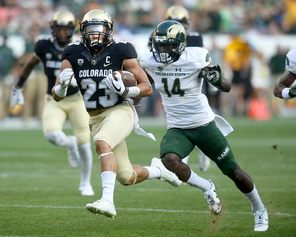 . Phillip Lindsay, of CU, gets past Anthony Hawkins, of CSU, for the TD run during the first half of the Rocky Mountain Showdown in Denver.  Cliff Grassmick / Staff Photographer/ September 1, 2017