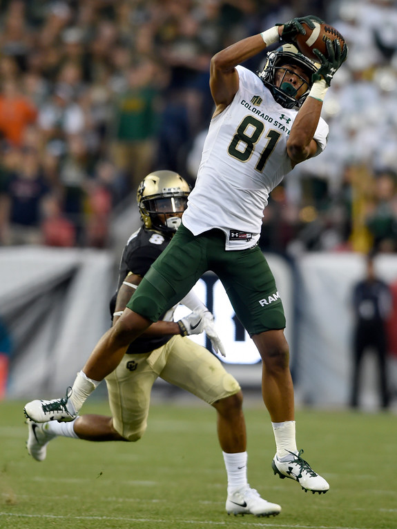 . Colorado State University\'s Olabisi Johnson makes a catch in front of Trey Udoffia during the Rocky Mountain Showdown against the University of Colorado on Friday at Sports Authority Field in Denver. CU won the game 17-3. More photos: Buffzone.com Jeremy Papasso/ Staff Photographer/ Sept. 1, 2017