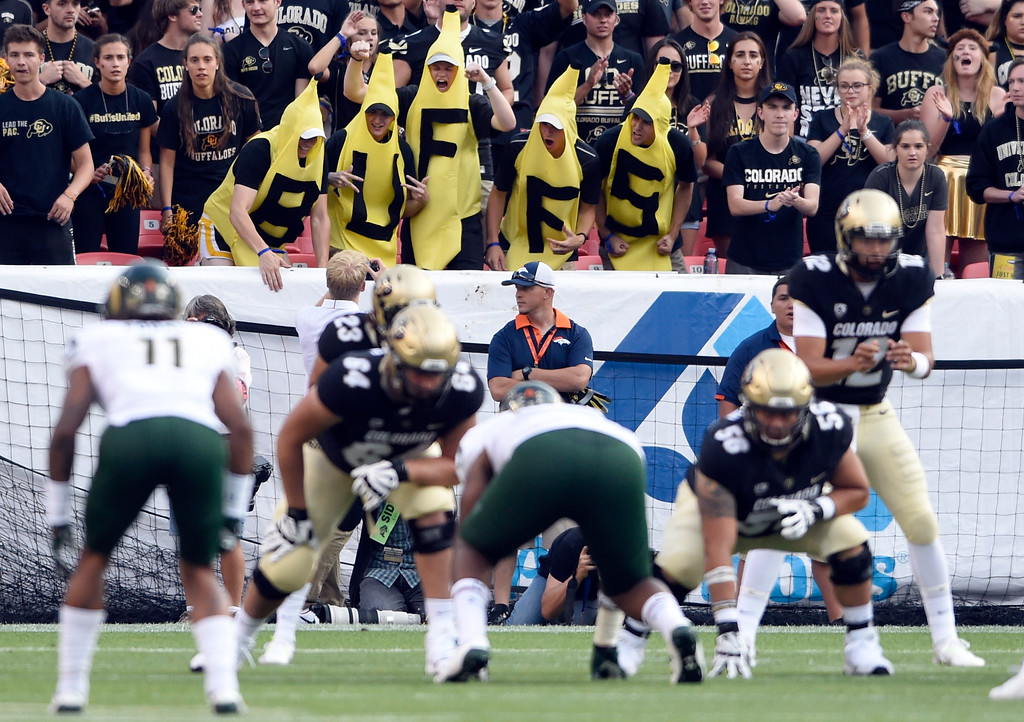 . University of Colorado fans dressed as bananas cheer behind the CU offense during the Rocky Mountain Showdown against Colorado State University on Friday at Sports Authority Field in Denver. More photos: Buffzone.com Jeremy Papasso/ Staff Photographer/ Sept. 1, 2017