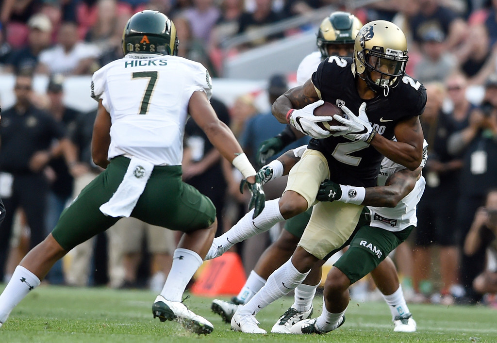 . University of Colorado\'s Devin Ross runs the ball after making a catch during the Rocky Mountain Showdown against Colorado State University on Friday at Sports Authority Field in Denver. CU won the game 17-3. More photos: Buffzone.com Jeremy Papasso/ Staff Photographer/ Sept. 1, 2017