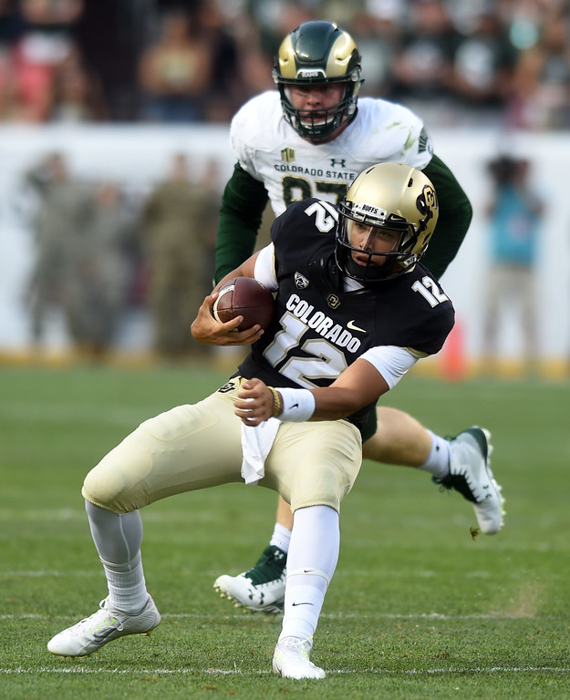 . Steven Montez, of CU, has a nice run called back on a penalty during the first half of the Rocky Mountain Showdown in Denver.  Cliff Grassmick / Staff Photographer/ September 1, 2017