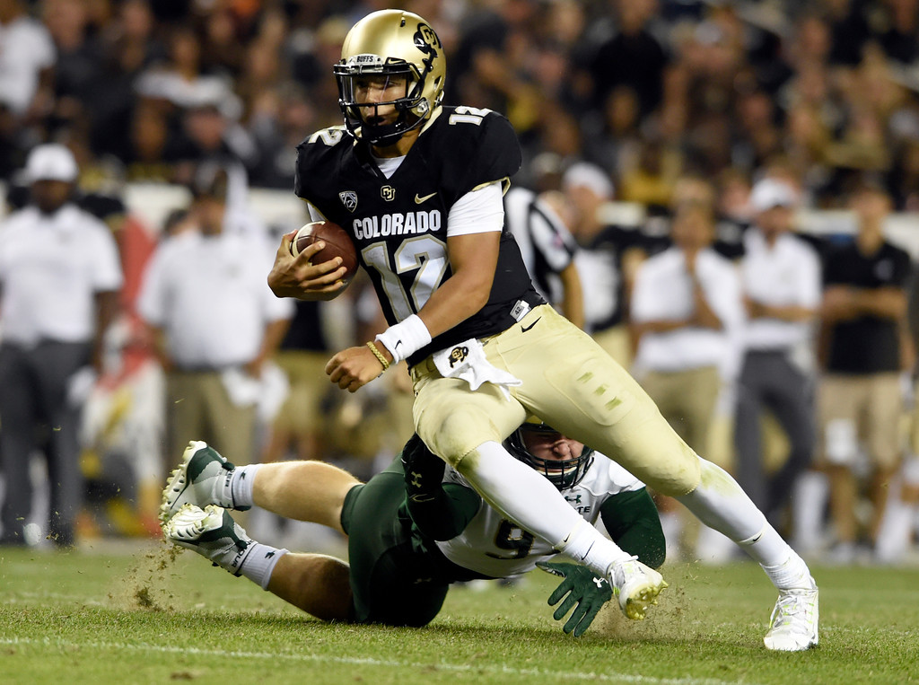 . University of Colorado quarterback Steven Montez rushes the ball during the Rocky Mountain Showdown against Colorado State University on Friday at Sports Authority Field in Denver. CU won the game 17-3. More photos: Buffzone.com Jeremy Papasso/ Staff Photographer/ Sept. 1, 2017