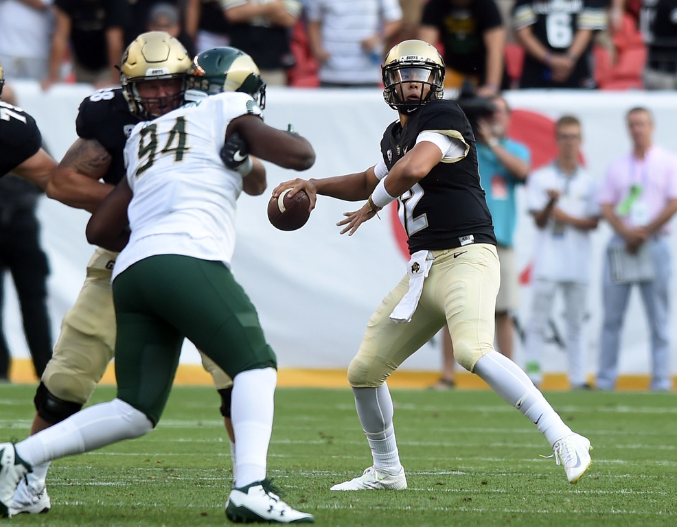 . Steven Montez, of CU, winds up to throw a pass down field during the first half of the Rocky Mountain Showdown in Denver.  Cliff Grassmick / Staff Photographer/ September 1, 2017