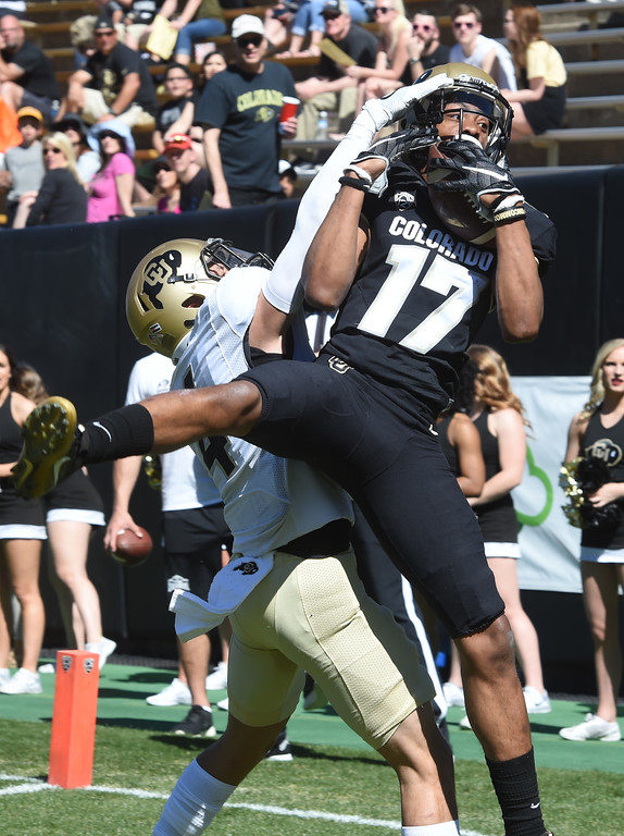 . Kabion Ento catches a touchdown pass over Dante Wigley during the 2017 CU Spring Football Game on Saturday. For more photos, go to www.Buffzone.com Cliff Grassmick  Staff Photographer March 18, 2017