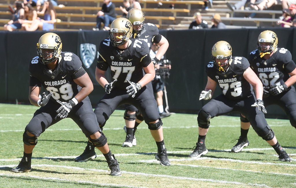 . O-line, Mo Bandi, left, Hunter Vaughn, Isaac Miller, and Justin Eggers, during the 2017 CU Spring Football Game on Saturday. For more photos, go to www.Buffzone.com Cliff Grassmick  Staff Photographer March 18, 2017