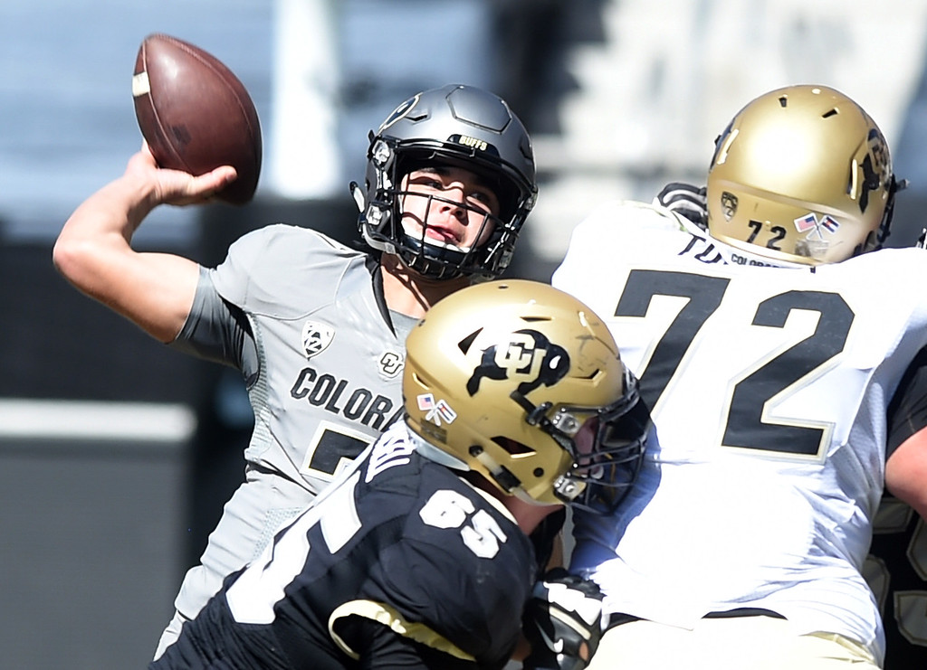 . CU QB, Tyler Lytle, throws down field during the 2017 CU Spring Football Game on Saturday. For more photos, go to www.Buffzone.com Cliff Grassmick  Staff Photographer March 18, 2017