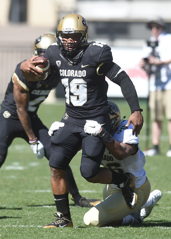 . Michael Adkins II runs the ball  during the 2017 CU Spring Football Game on Saturday. For more photos, go to www.Buffzone.com Cliff Grassmick  Staff Photographer March 18, 2017
