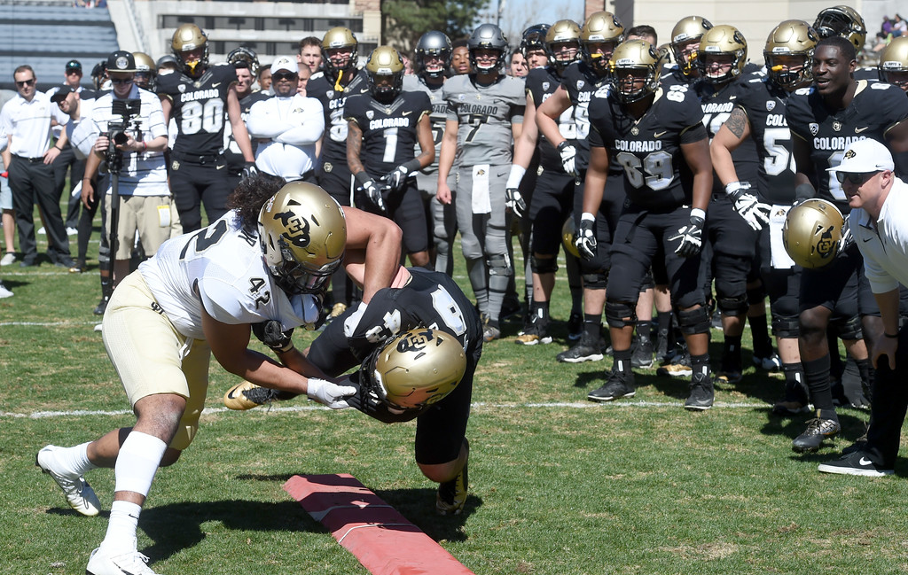 . N.J.Falo, left, and Chris Bounds, battle during drills during the 2017 CU Spring Football Game on Saturday. For more photos, go to www.Buffzone.com Cliff Grassmick  Staff Photographer March 18, 2017