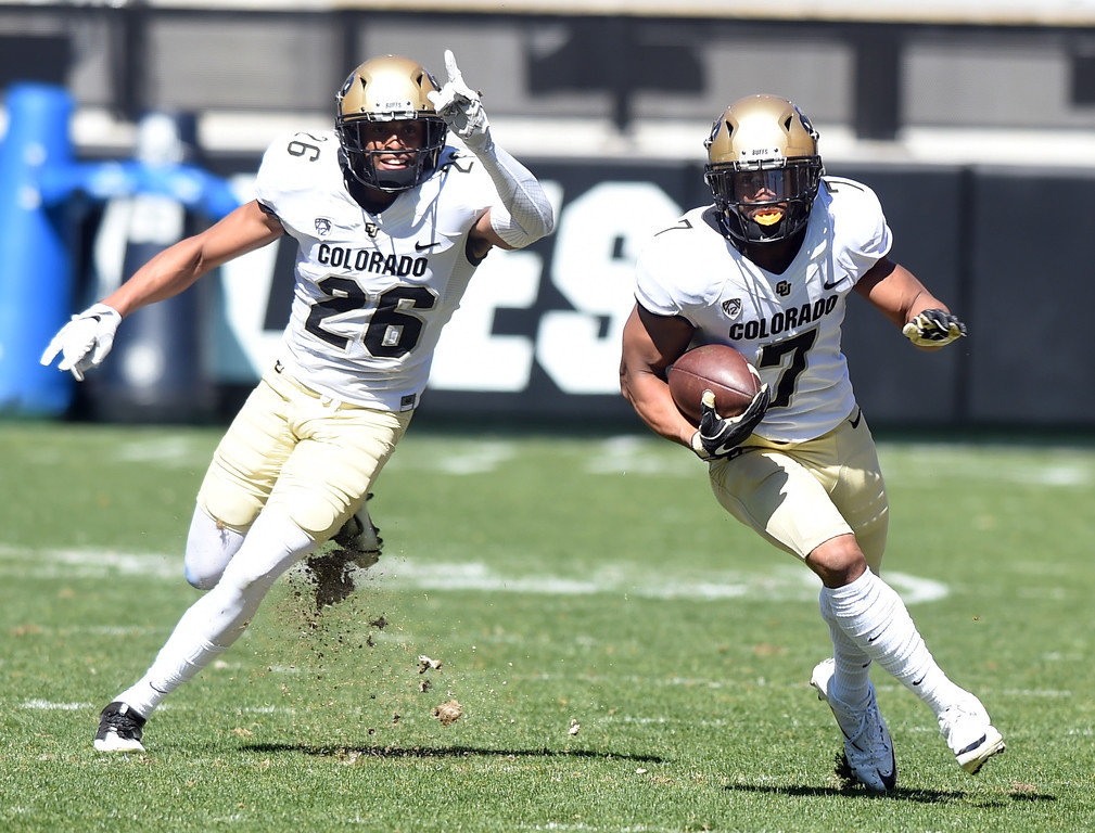 . Nick Fisher, runs back an interception as Isaiah Oliver cheers him on,   during the 2017 CU Spring Football Game on Saturday. For more photos, go to www.Buffzone.com Cliff Grassmick  Staff Photographer March 18, 2017