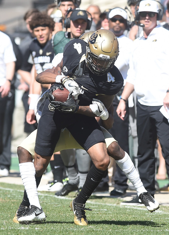 . Bryce Bobo on a catch during the 2017 CU Spring Football Game on Saturday. For more photos, go to www.Buffzone.com Cliff Grassmick  Staff Photographer March 18, 2017