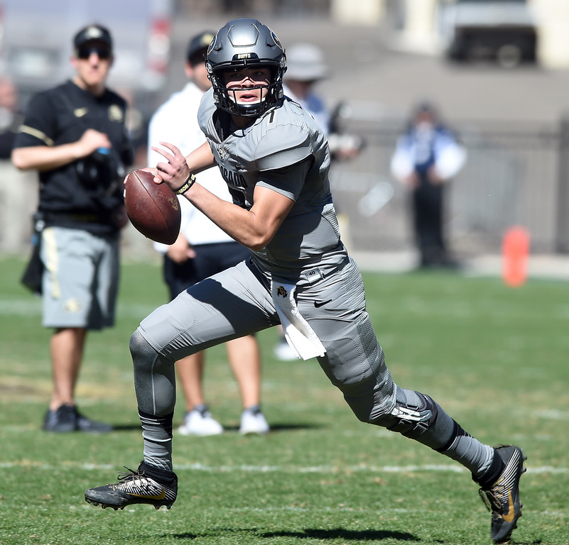 . CU QB, Tyler Lytle, looks for room during the 2017 CU Spring Football Game on Saturday. For more photos, go to www.Buffzone.com Cliff Grassmick  Staff Photographer March 18, 2017