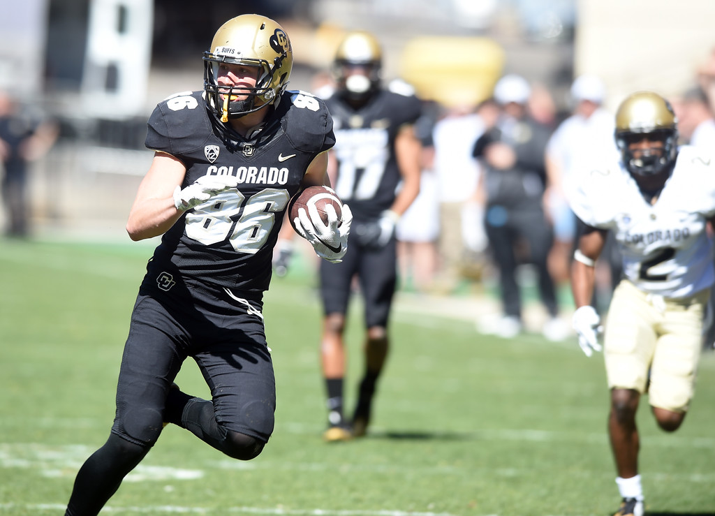 . Dylan Keeney takes off with a pass during the 2017 CU Spring Football Game on Saturday. For more photos, go to www.Buffzone.com Cliff Grassmick  Staff Photographer March 18, 2017