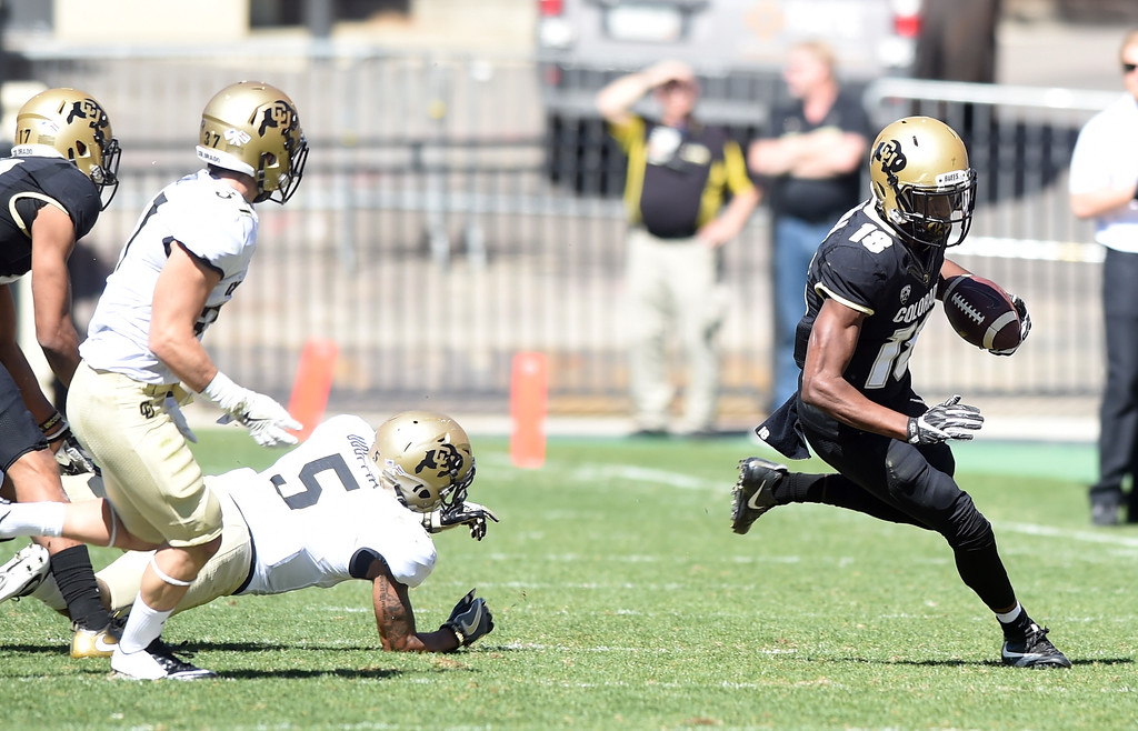 . Lee Walker takes off with a pass during the 2017 CU Spring Football Game on Saturday. For more photos, go to www.Buffzone.com Cliff Grassmick  Staff Photographer March 18, 2017