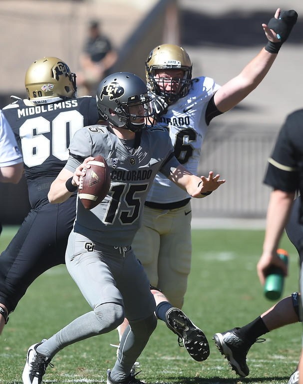 . CU QB, Sam Noyer, is pressured  by Jase Franke during the 2017 CU Spring Football Game on Saturday. For more photos, go to www.Buffzone.com Cliff Grassmick  Staff Photographer March 18, 2017