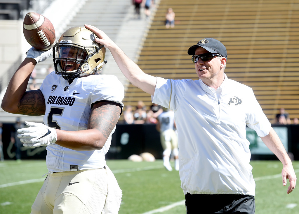 . George Frazier, left, and assistant,  Ross Els, have a nice moment during the 2017 CU Spring Football Game on Saturday. For more photos, go to www.Buffzone.com Cliff Grassmick  Staff Photographer March 18, 2017