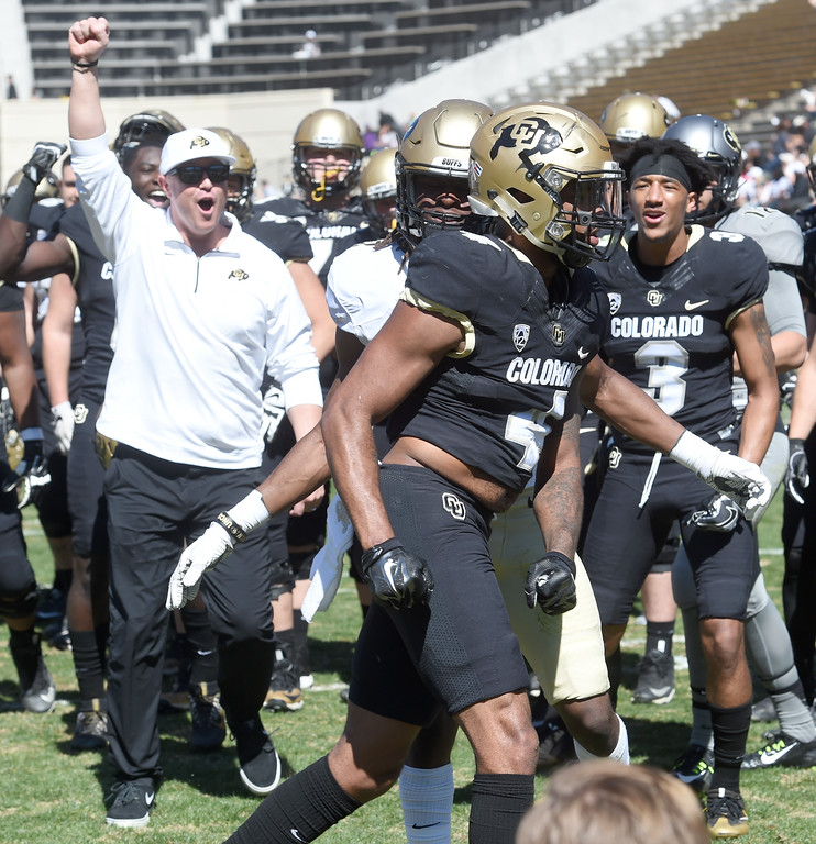 . Darrin Chiaverini, left, is excited by the results of the drill with Bryce Bobo, during the 2017 CU Spring Football Game on Saturday. For more photos, go to www.Buffzone.com Cliff Grassmick  Staff Photographer March 18, 2017