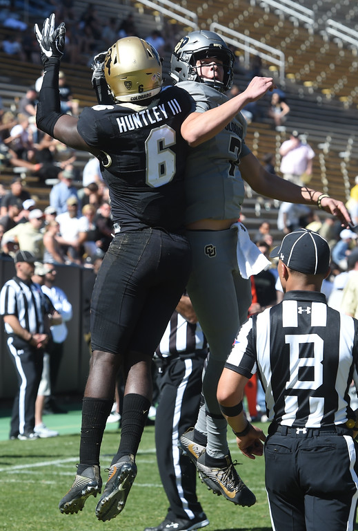 . Johnny Huntley III, left, and TYler Lytle, celebrate their TD connection  during the 2017 CU Spring Football Game on Saturday. For more photos, go to www.Buffzone.com Cliff Grassmick  Staff Photographer March 18, 2017
