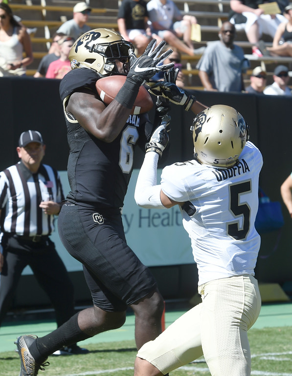 . Johnny Huntley III catches a TD in front of Trey Udoffia during the 2017 CU Spring Football Game on Saturday. For more photos, go to www.Buffzone.com Cliff Grassmick  Staff Photographer March 18, 2017