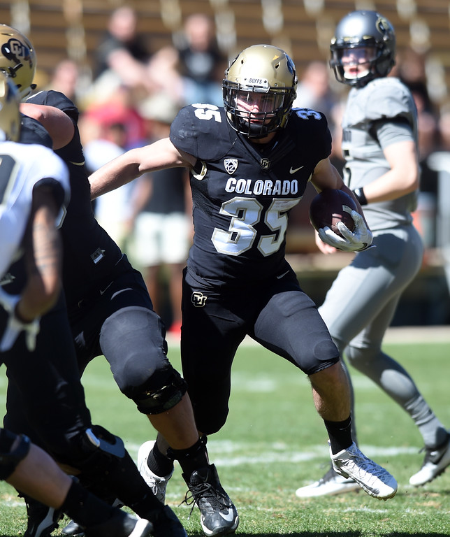 . Beau Bisharat runs the ball during the 2017 CU Spring Football Game on Saturday. For more photos, go to www.Buffzone.com Cliff Grassmick  Staff Photographer March 18, 2017