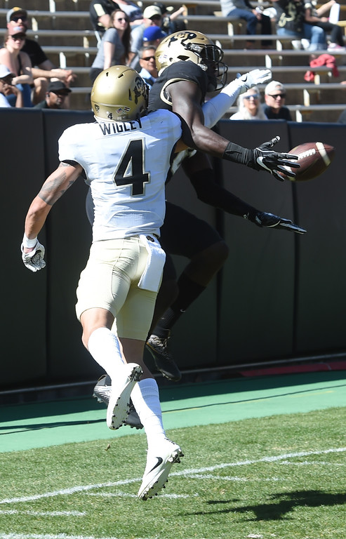 . Johnny Huntley III catches a touchdown past Dante Wigley during the 2017 CU Spring Football Game on Saturday. For more photos, go to www.Buffzone.com Cliff Grassmick  Staff Photographer March 18, 2017