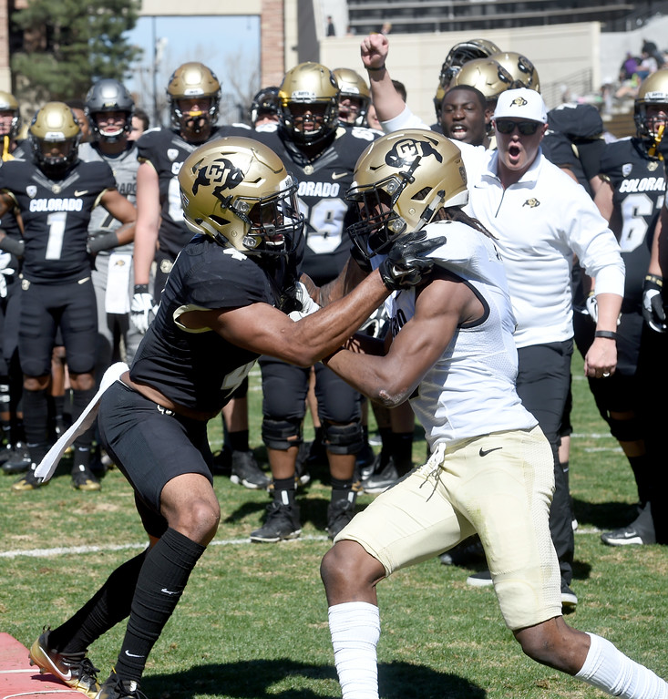 . Bryce Bobo, left, and Anthony Julmisse, battle during drills during the 2017 CU Spring Football Game on Saturday. For more photos, go to www.Buffzone.com Cliff Grassmick  Staff Photographer March 18, 2017