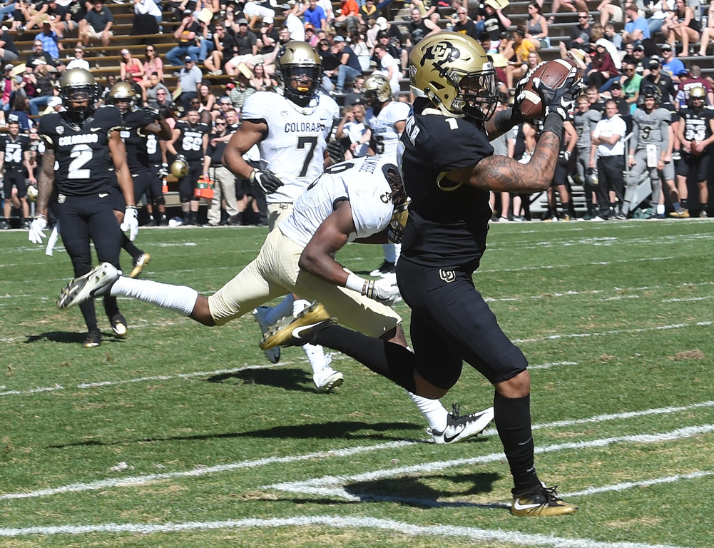 . Shay Fields catches a touchdown past Anthony Julmisse during the 2017 CU Spring Football Game on Saturday. For more photos, go to www.Buffzone.com Cliff Grassmick  Staff Photographer March 18, 2017