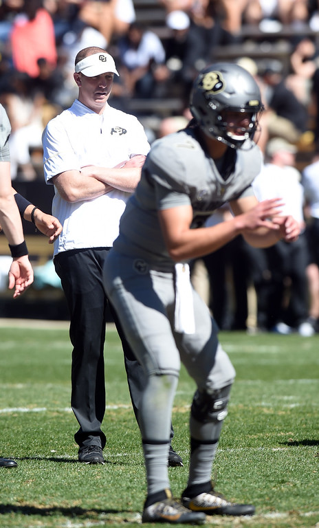. Brian Lindgren, left, during the 2017 CU Spring Football Game on Saturday. For more photos, go to www.Buffzone.com Cliff Grassmick  Staff Photographer March 18, 2017