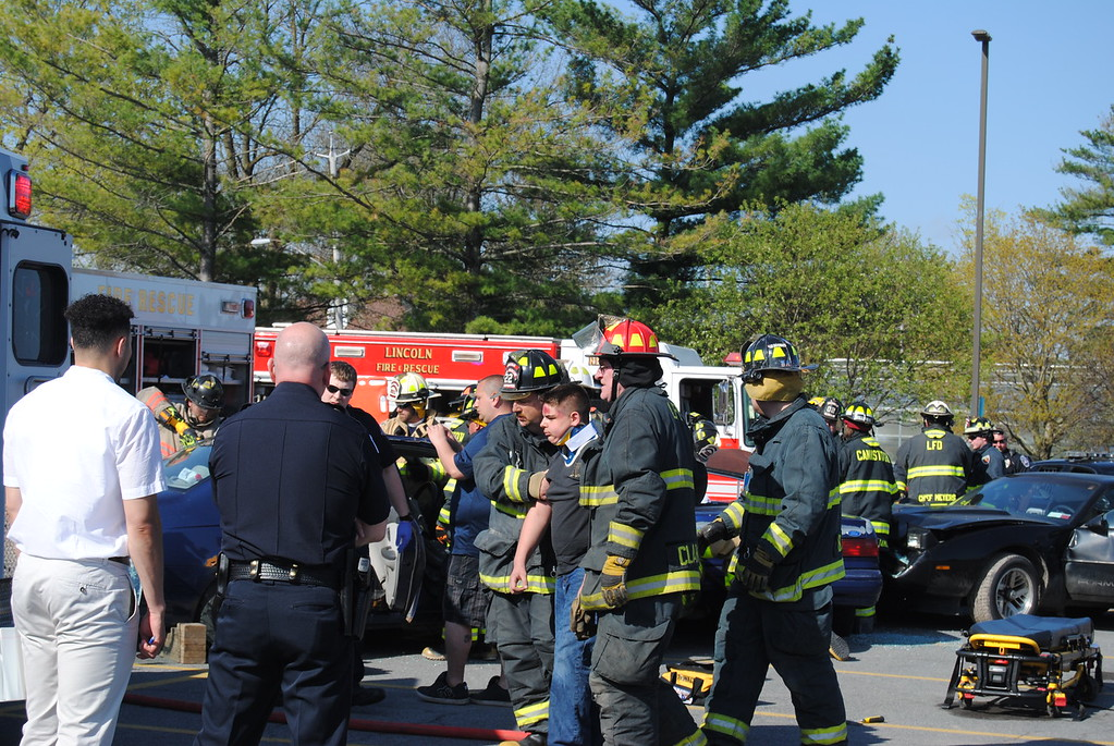 . Leah McDonald - Oneida Daily Dispatch Students and emergency personnel, including the Canastota Police Department, Canastota Volunteer Fire Department, the Greater Lenox Ambulance Service, and J. Homer Ball Funeral Home take part in a mock DWI accident at Canastota High School on Thursday, April 27, 2017.
