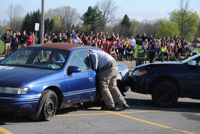 Leah McDonald - Oneida Daily Dispatch Students and emergency personnel, including the Canastota Police Department, Canastota Volunteer Fire Department, the Greater Lenox Ambulance Service, and J. Homer Ball Funeral Home take part in a mock DWI accident at Canastota High School on Thursday, April 27, 2017.