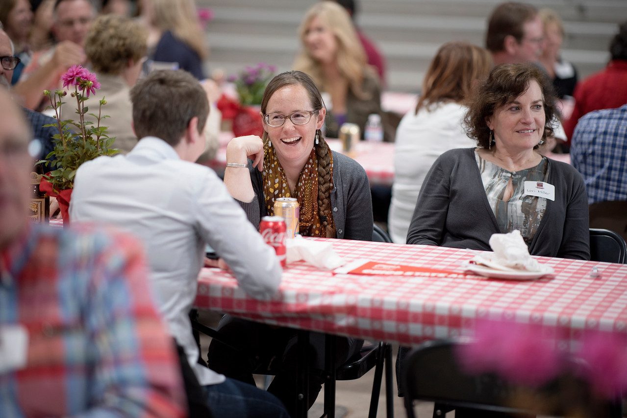 Ashley Gebb (left) and Lori Miller (right) enjoy conversations with fellow guests at the Alumni Spring Barbecue that is held at the University Farm on Thursday, April 27, 2017, in Chico, Calif.  (Jessica Bartlett/ Photographer)