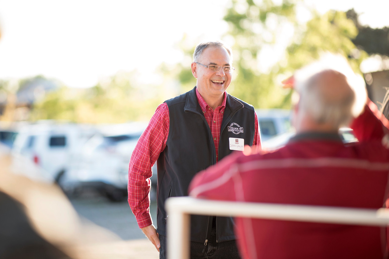 John Unruh provides a tour of the farm to the guests at the Alumni Spring Barbecue that is held at the University Farm on Thursday, April 27, 2017, in Chico, Calif.  (Jessica Bartlett/ Photographer)
