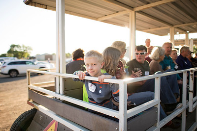 Tayton Kalberer is taken on a tour of the farm along with fellow guests at the Alumni Spring Barbecue that is held at the University Farm on Thursday, April 27, 2017, in Chico, Calif.  (Jessica Bartlett/ Photographer)