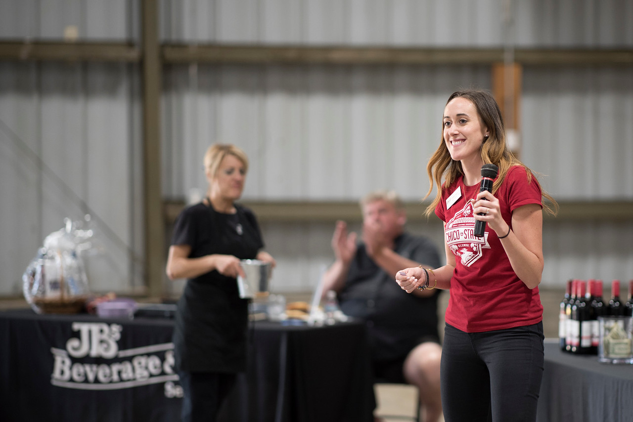 Kaitlin Tillett speaks to the guests at the Alumni Spring Barbecue that is held at the University Farm on Thursday, April 27, 2017, in Chico, Calif.  (Jessica Bartlett/ Photographer)