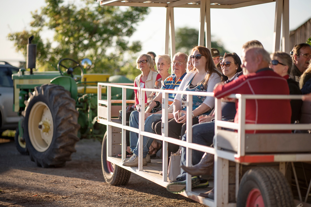 Guests are taken on a tour of the farm at the Alumni Spring Barbecue that is held at the University Farm on Thursday, April 27, 2017, in Chico, Calif.  (Jessica Bartlett/ Photographer)